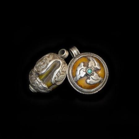 Two Antique Tibetan Resin Silver Amulet Pendants