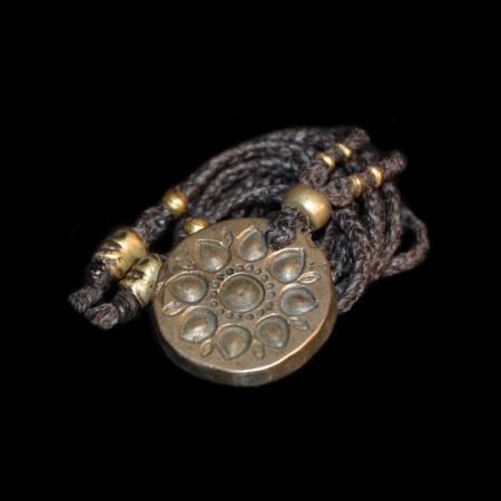 Antique hindu bronze sun amulet