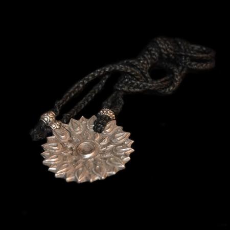 Large sun silver amulet