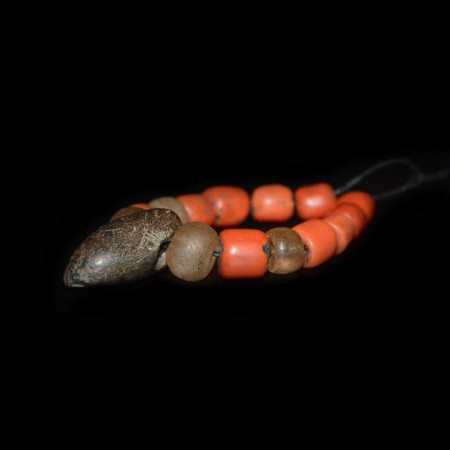Strand with red Coral and neolithic Beads