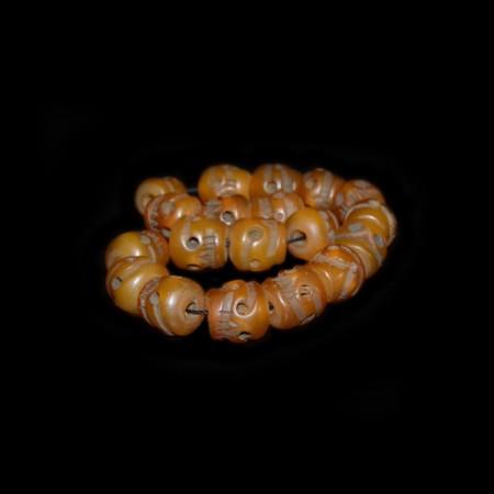 Tibetan Simulated Amber Skull Beads