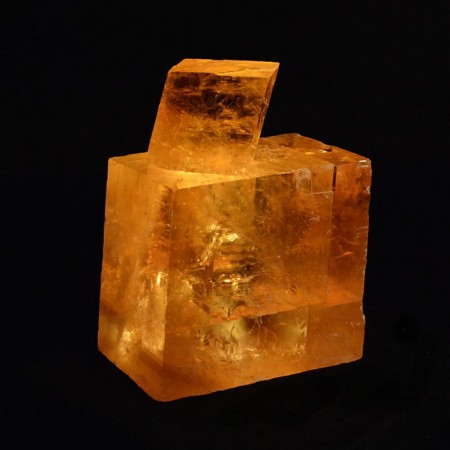 Two naturally grown calcite crystals with LED light