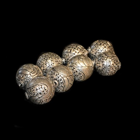 Silver repoussee metal beads