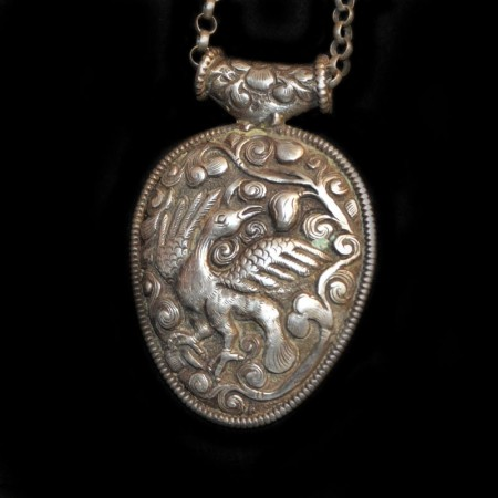 Large old Silver Repoussee Bird Amulet